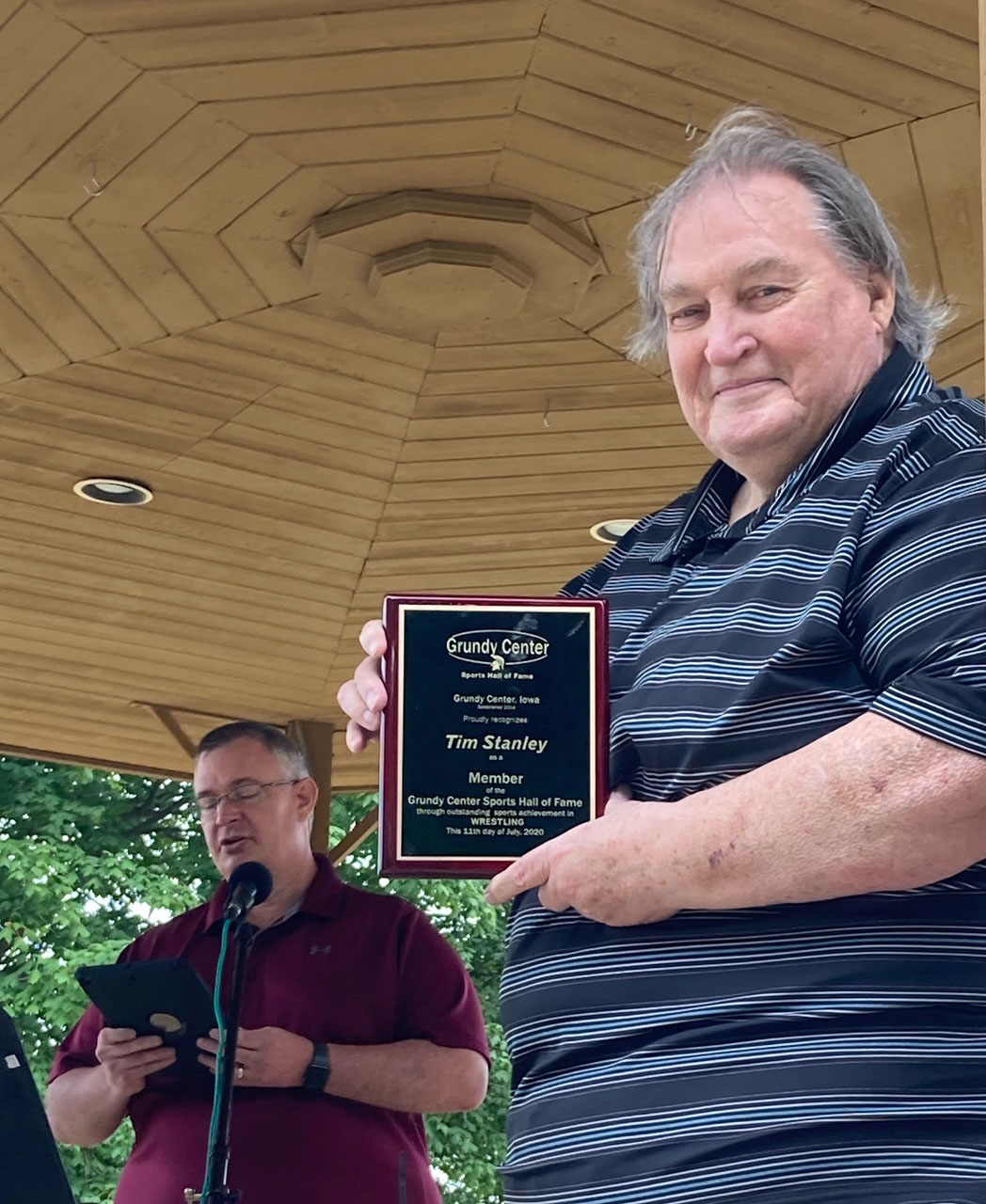 Tim Stanley was honored for his achievement in wrestling with Grundy Center. Doug Van Gelder accepted the award in Stanley's honor.